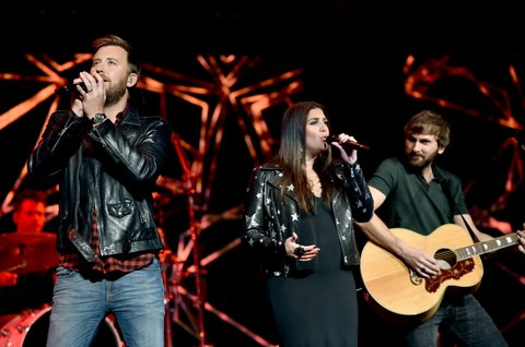 NASHVILLE, TN - NOVEMBER 12:  In this handout photo provided by The Country Rising Fund of The Community Foundation of Middle Tennessee,  (L-R) Singers Charles Kelley, Hillary Scott, and Dave Haywood of Lady Antebellum perform onstage for the Country Rising Benefit Concert at Bridgestone Arena on November 12, 2017 in Nashville, Tennessee.  (Photo by John Shearer/Country Rising/Getty Images)