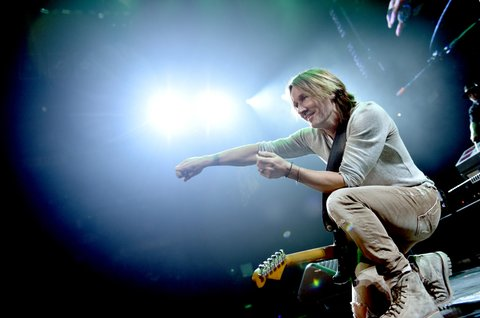 NASHVILLE, TN - NOVEMBER 12:  In this handout photo provided by The Country Rising Fund of The Community Foundation of Middle Tennessee, musical artist Keith Urban performs onstage for the Country Rising Benefit Concert at Bridgestone Arena on November 12, 2017 in Nashville, Tennessee.  (Photo by John Shearer/Country Rising/Getty Images)