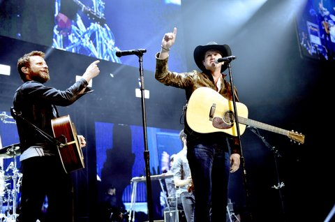 NASHVILLE, TN - NOVEMBER 12:  In this handout photo provided by The Country Rising Fund of The Community Foundation of Middle Tennessee, Musical artists Dierks Bentley and Jon Pardi perform onstage for the Country Rising Benefit Concert at Bridgestone Arena on November 12, 2017 in Nashville, Tennessee.  (Photo by John Shearer/Country Rising/Getty Images)