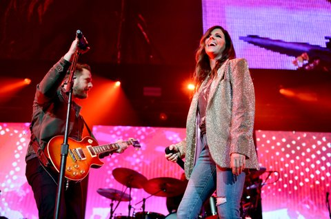 NASHVILLE, TN - NOVEMBER 12:  In this handout photo provided by The Country Rising Fund of The Community Foundation of Middle Tennessee, Jimi Westbrook and Karen Fairchild of Little Big Town perform onstage for the Country Rising Benefit Concert at Bridgestone Arena on November 12, 2017 in Nashville, Tennessee.  (Photo by John Shearer/Country Rising/Getty Images)