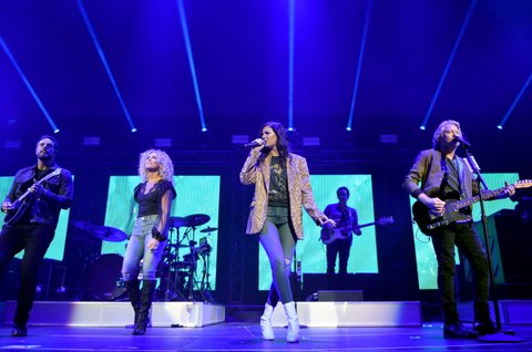 NASHVILLE, TN - NOVEMBER 12:  In this handout photo provided by The Country Rising Fund of The Community Foundation of Middle Tennessee, (L-R) Jimi Westbrook, Kimberly Schlapman, Karen Fairchild and Philip Sweet of Little Big Town perform onstage for the Country Rising Benefit Concert at Bridgestone Arena on November 12, 2017 in Nashville, Tennessee.  (Photo by John Shearer/Country Rising/Getty Images)