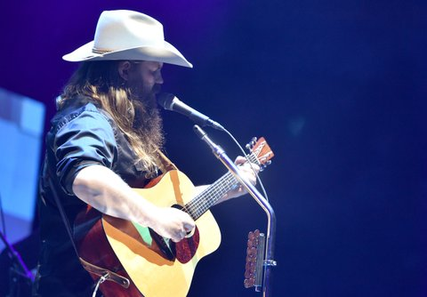 NASHVILLE, TN - NOVEMBER 12:  In this handout photo provided by The Country Rising Fund of The Community Foundation of Middle Tennessee, singer-songwriter Chris Stapleton performs onstage for the Country Rising Benefit Concert at Bridgestone Arena on November 12, 2017 in Nashville, Tennessee.  (Photo by John Shearer/Country Rising/Getty Images)