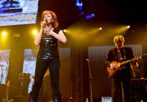 NASHVILLE, TN - NOVEMBER 12:  In this handout photo provided by The Country Rising Fund of The Community Foundation of Middle Tennessee, Reba McEntire performs onstage for the Country Rising Benefit Concert at Bridgestone Arena on November 12, 2017 in Nashville, Tennessee.  (Photo by John Shearer/Country Rising/Getty Images)