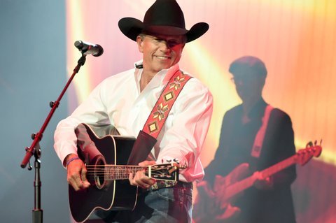 NASHVILLE, TN - NOVEMBER 12:  In this handout photo provided by The Country Rising Fund of The Community Foundation of Middle Tennessee, singer-songwriter George Strait performs onstage for the Country Rising Benefit Concert at Bridgestone Arena on November 12, 2017 in Nashville, Tennessee.  (Photo by Rick Diamond/Country Rising/Getty Images)