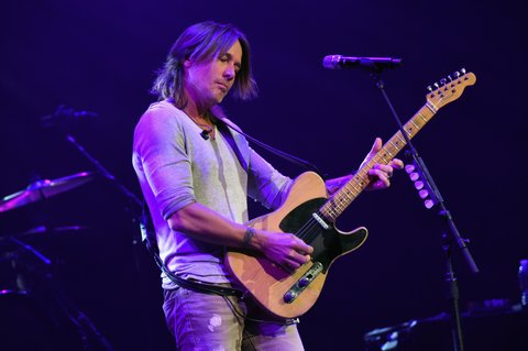 NASHVILLE, TN - NOVEMBER 12:  In this handout photo provided by The Country Rising Fund of The Community Foundation of Middle Tennessee, musical artist Keith Urban performs onstage for the Country Rising Benefit Concert at Bridgestone Arena on November 12, 2017 in Nashville, Tennessee.  (Photo by Rick Diamond/Country Rising/Getty Images)
