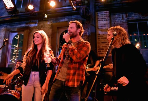 NASHVILLE, TN - JANUARY 14:  Tae Dye (L) and Maddie Marlow (R) of Maddie & Tae and Dierks Bentley speak onstage during the Nashville Opening of Dierks Bentley's Whiskey Row on January 14, 2018 in Nashville, Tennesse  (Photo by John Shearer/Getty Images for Dierks Bentley's Whiskey Row Nashville)