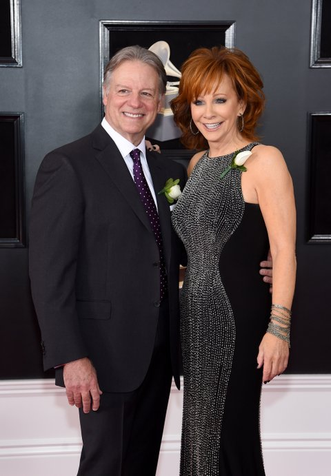 NEW YORK, NY - JANUARY 28:  Anthony 'Skeeter' Lasuzzo (L) and recording artist Reba McEntire attend the 60th Annual GRAMMY Awards at Madison Square Garden on January 28, 2018 in New York City.  (Photo by Jamie McCarthy/Getty Images)