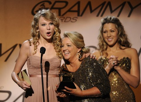 Taylor Swift (L) and songwriter Liz Rose (C) celebrate after winning the Best Country Song award for White Horse during the Pre-Telecast award presentations at the 52nd Grammy Awards in Los Angeles on January 31, 2010.                AFP PHOTO/Robyn BECK (Photo credit should read ROBYN BECK/AFP/Getty Images)