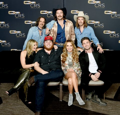 NASHVILLE, TN - FEBRUARY 07:  Cameron Duddy, Mark Wystrach and Jess Carson of Midland, Lauren Alaina, Luke Combs, Carly Pearce and Michael Ray take photos backstage for New Faces of Country Music Show for Day 3 of CRS 2018 on February 7, 2018 in Nashville, Tennessee.  (Photo by Rick Diamond/Getty Images for CRS)