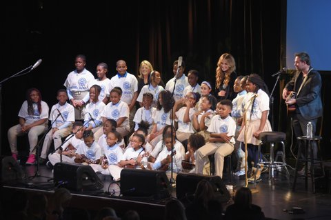 NEW YORK, NY - FEBRUARY 12:  Students of P.S.169 Baychester Academy perform with Liz Rose, Carly Pearce and Phil Barton onstage at the Country Music Hall of Fame and Museum's 'All for the Hall' Benefit on February 13, 2018 in New York City.  (Photo by Michael Loccisano/Getty Images for Country Music Hall Of Fame)
