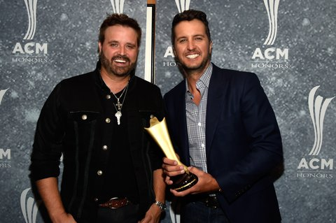 NASHVILLE, TN - SEPTEMBER 01: Randy Owen and Gene Weed Special Achievement Award recipient Luke Bryan pose backstage during the 9th Annual ACM Honors at the Ryman Auditorium on September 1, 2015 in Nashville, Tennessee.  (Photo by Rick Diamond/Getty Images for ACM)