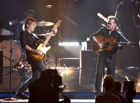 NASHVILLE, TN - NOVEMBER 04: Musicians Keith Urban (L) and John Mellencamp perform onstage at the 49th annual CMA Awards at the Bridgestone Arena on November 4, 2015 in Nashville, Tennessee. (Photo by Frederick Breedon/FilmMagic)