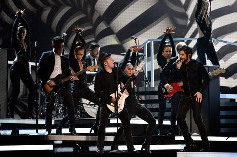 NASHVILLE, TN - NOVEMBER 04:  Thomas Rhett performs with Fall Out Boy onstage at the 49th annual CMA Awards at the Bridgestone Arena on November 4, 2015 in Nashville, Tennessee.  (Photo by Frederick Breedon/FilmMagic)