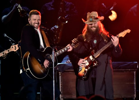 NASHVILLE, TN - NOVEMBER 04:  Musician Justin Timberlake (L) performs onstage with Singer-songwriter Chris Stapleton (R)performs onstage at the 49th annual CMA Awards at the Bridgestone Arena on November 4, 2015 in Nashville, Tennessee.  (Photo by Frederick Breedon/FilmMagic)