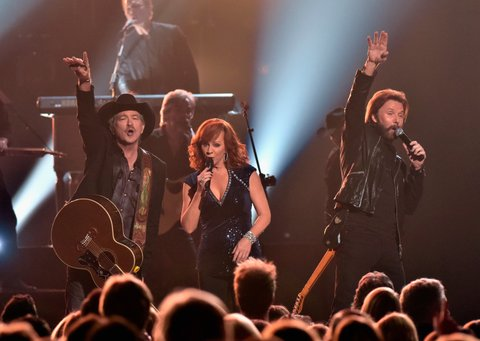 NASHVILLE, TN - NOVEMBER 04: (L-R) Kix Brooks, Reba McEntire and Ronnie Dunn perform onstage at the 49th annual CMA Awards at the Bridgestone Arena on November 4, 2015 in Nashville, Tennessee. (Photo by Frederick Breedon/FilmMagic)