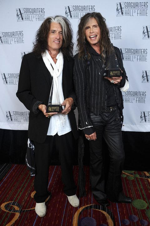 NEW YORK, NY - JUNE 13:  Joe Perry and Steven Tyler of Aerosmith attend the Songwriters Hall of Fame 44th Annual Induction and Awards Dinner at the New York Marriott Marquis on June 13, 2013 in New York City.  (Photo by Gary Gershoff/Getty Images for Songwriters Hall Of Fame)