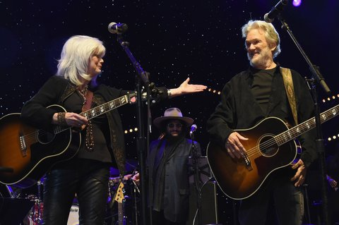 NASHVILLE, TENNESSEE - MARCH 16:  Emmylou Harris and Kris Kristofferson perform at The Life & Songs of Kris Kristofferson produced by Blackbird Presents at Bridgestone Arena on March 16, 2016 in Nashville, Tennessee.  (Photo by Rick Diamond/Getty Images for Essential Broadcast Media)