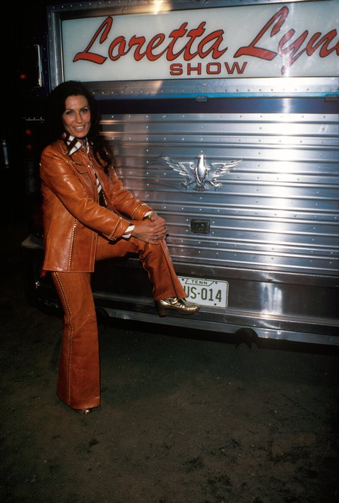 Country singer and songwriter Loretta Lynn posing in front of her tour bus at Great Adventure on August 23, 1975 in New Jersey.