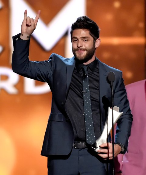 LAS VEGAS, NEVADA - APRIL 03:  Recording artist Thomas Rhett accepts the Single Record of the Year award for 'Die a Happy Man' onstage during the 51st Academy of Country Music Awards at MGM Grand Garden Arena on April 3, 2016 in Las Vegas, Nevada.  (Photo by Ethan Miller/Getty Images)