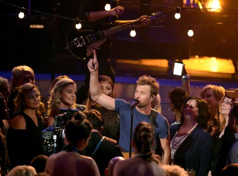 LAS VEGAS, NEVADA - APRIL 03: Co-host Dierks Bentley (C) performs during the 51st Academy of Country Music Awards at MGM Grand Garden Arena on April 3, 2016 in Las Vegas, Nevada.