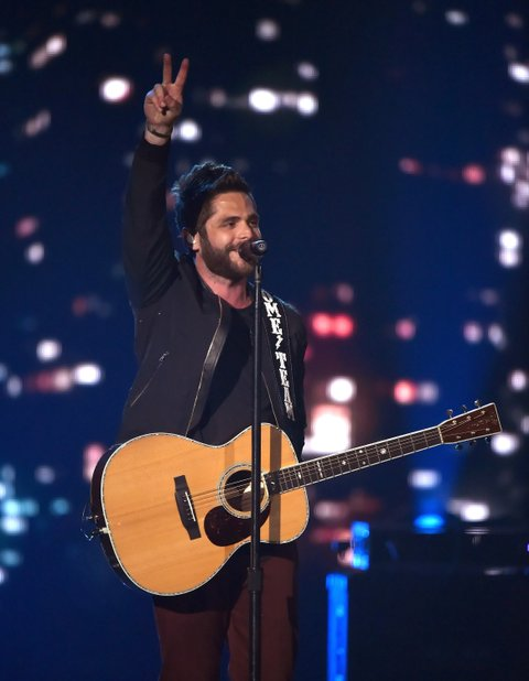 LAS VEGAS, NEVADA - APRIL 03: Recording artist Thomas Rhett performs onstage during the 51st Academy of Country Music Awards at MGM Grand Garden Arena on April 3, 2016 in Las Vegas, Nevada.