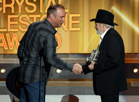 LAS VEGAS, NV - APRIL 06:  Singer/songwriter Merle Haggard (R) accepts the ACM Crystal Milestone Award from recording artist Garth Brooks during the 49th Annual Academy of Country Music Awards at the MGM Grand Garden Arena on April 6, 2014 in Las Vegas, Nevada.  (Photo by Ethan Miller/Getty Images)