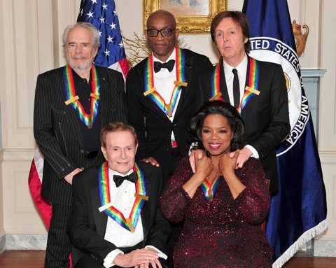 WASHINGTON, D.C. - DECEMBER 04:  The 2010 Kennedy Center honorees pose for their formal class photo following the formal Artist's Dinner at the United States Department of State in Washington, D.C. on December 4, 2010.  Top row, from left to right: Merle Haggard, Bill T. Jones, and Sir Paul McCartney. Bottom row, from left to right: Jerry Herman and Oprah Winfrey. (Photo by Ron Sachs-Pool/Getty Images).
