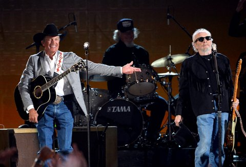 LAS VEGAS, NV - APRIL 07:  Recording artists George Strait (L) and Merle Haggard perform onstage during ACM Presents: An All-Star Salute To The Troops at the MGM Grand Garden Arena on April 7, 2014 in Las Vegas, Nevada.  (Photo by Ethan Miller/Getty Images for ACM)