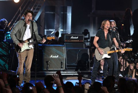 John Mayer and Keith Urban perform onstage during the 2010 CMT Music Awards at the Bridgestone Arena on June 9, 2010 in Nashville, Tennessee. (Photo by Frederick Breedon IV/WireImage)
