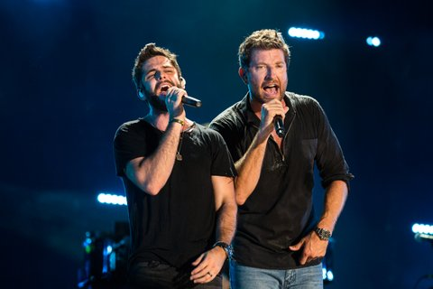 NASHVILLE, TN - JUNE 12: Thomas Rhett and Brett Eldredge perform during the 2016 CMA Music Festival at Nissan Stadium on June 12, 2016 in Nashville, Tennessee. (Photo by Richard Gabriel Ford/Getty Images)