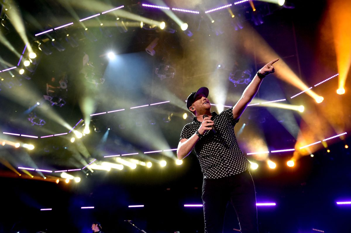 NASHVILLE, TN - JUNE 11:  Singer-songwriter Cole Swindell performs onstage during 2016 CMA Festival - Day 3 at Nissan Stadium on June 11, 2016 in Nashville, Tennessee.  (Photo by John Shearer/Getty Images)