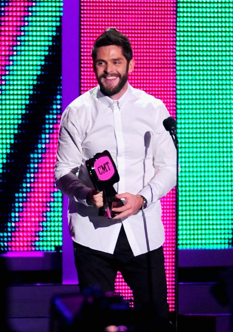 NASHVILLE, TN - JUNE 08:  Singer-songwriter Thomas Rhett accepts award onstage during the 2016 CMT Music awards at the Bridgestone Arena on June 8, 2016 in Nashville, Tennessee.  (Photo by FilmMagic/FilmMagic)