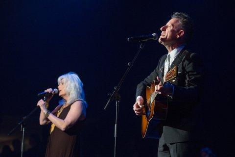NASHVILLE, TN - AUGUST 16:  Emmylou Harris (L) and Lyle Lovett perform at Ryman Auditorium on August 16, 2016 in Nashville, Tennessee.  (Photo by Erika Goldring/Getty Images)