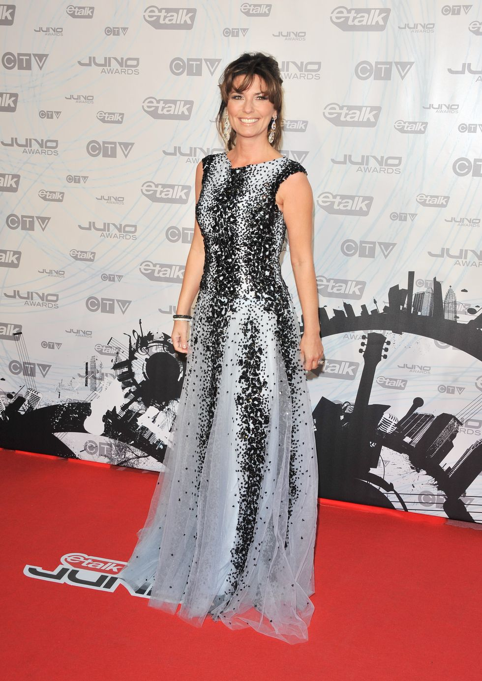 TORONTO, ON - MARCH 27:  Singer/Canadian music Hall of Fame Inductee Shania Twain poses on the red carpet at the 2011 Juno Awards at the Air Canada Centre on March 27, 2011 in Toronto, Canada.  (Photo by George Pimentel/WireImage)