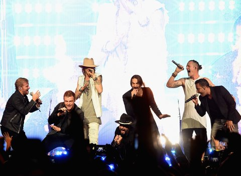 NASHVILLE, TN - OCTOBER 13:  Backstreet Boys (in black), Brian Littell, Nick Carter, A.J. McLean, Brian Richardson and Howie D. join Brian Kelley and Tyler Hubbard of Florida Georgia Line during their Dig Your Roots 2016 Tour at Bridgestone Arena on October 13, 2016 in Nashville, Tennessee.  (Photo by Rick Diamond/Getty Images)