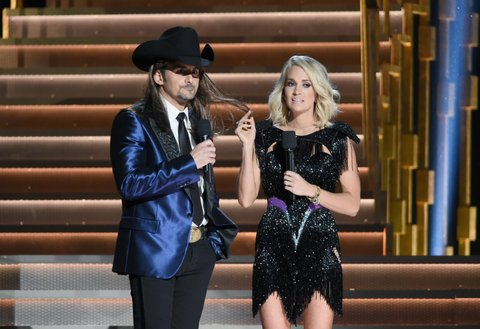 NASHVILLE, TN - NOVEMBER 02:  Hosts Brad Paisley and Carrie Underwood speak onstage at the 50th annual CMA Awards at the Bridgestone Arena on November 2, 2016 in Nashville, Tennessee.  (Photo by Erika Goldring/FilmMagic)