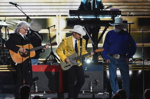 NASHVILLE, TN - NOVEMBER 02:  Ricky Skaggs, Brad Paisley, and Charlie Daniels perform onstage at the 50th annual CMA Awards at the Bridgestone Arena on November 2, 2016 in Nashville, Tennessee.  (Photo by Rick Diamond/Getty Images)