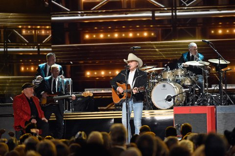 NASHVILLE, TN - NOVEMBER 02: Dwight Yoakam performs onstage at the 50th annual CMA Awards at the Bridgestone Arena on November 2, 2016 in Nashville, Tennessee.  (Photo by Gustavo Caballero/Getty Images)