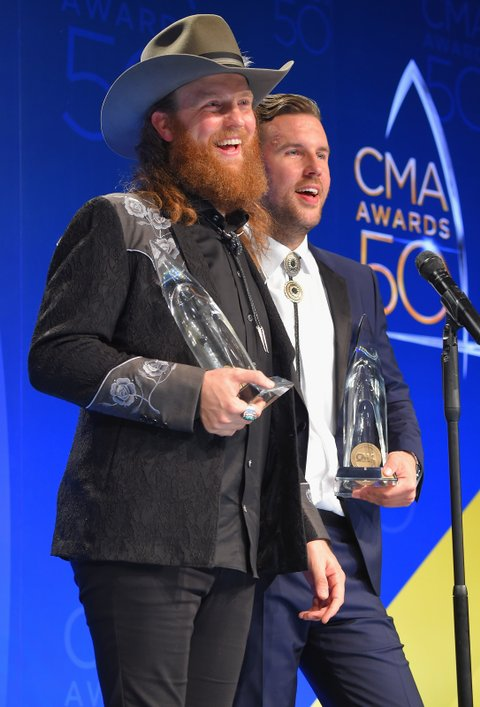 NASHVILLE, TN - NOVEMBER 02:  Musicians John Osborne (L) and  T.J. Osborne of Brothers Osborne speak in the press room during the 50th annual CMA Awards at the Bridgestone Arena on November 2, 2016 in Nashville, Tennessee.  (Photo by Michael Loccisano/Getty Images)