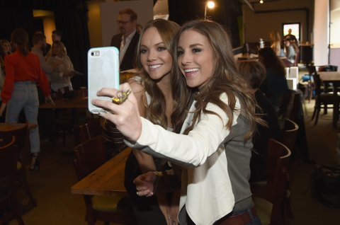 NASHVILLE, TN - NOVEMBER 07:  Singer-songwrtiers Danielle Bradbery and Tara Thompson take a selfie before the 2017 CMT Next Women Of Country Celebration at City Winery Nashville on November 7, 2017 in Nashville, Tennessee.  (Photo by Rick Diamond/Getty Images for CMT)