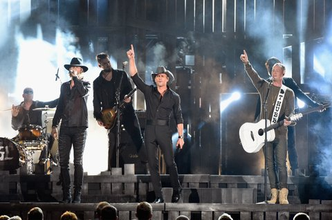 NASHVILLE, TN - NOVEMBER 02:  Brian Kelley, Tim McGraw, and Tyler Hubbard perform onstage at the 50th annual CMA Awards at the Bridgestone Arena on November 2, 2016 in Nashville, Tennessee.  (Photo by Gustavo Caballero/Getty Images)