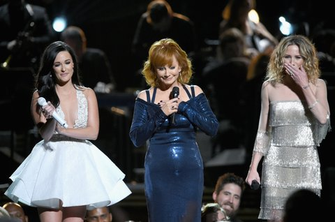 NASHVILLE, TN - NOVEMBER 02:  Kacey Musgraves, Reba McEntire, and Jennifer Nettles perform for Dolly Parton onstage at the 50th annual CMA Awards at the Bridgestone Arena on November 2, 2016 in Nashville, Tennessee.  (Photo by Erika Goldring/FilmMagic)