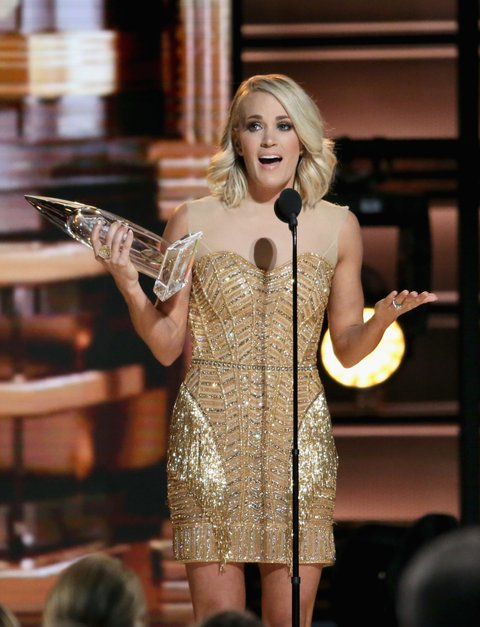 NASHVILLE, TN - NOVEMBER 02:  Carrie Underwood  accepts award onstage at the 50th annual CMA Awards at the Bridgestone Arena on November 2, 2016 in Nashville, Tennessee.  (Photo by Terry Wyatt/WireImage)