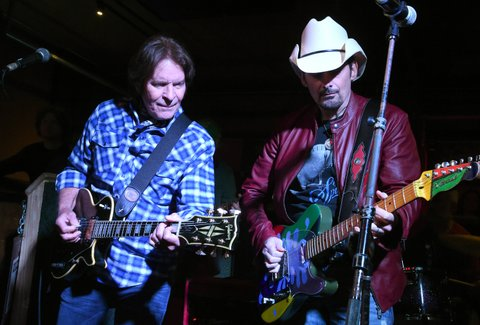 NASHVILLE, TN - APRIL 23:  John Fogerty and Brad Paisley perform onstage at Tootsie's Orchid Lounge after the Brad Paisley LOVE AND WAR Album Launch Event on April 23, 2017 in Nashville, Tennessee.  (Photo by Rick Diamond/Getty Images for Sony Music)