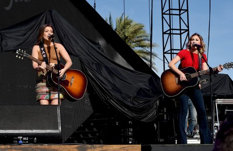 INDIO, CA - APRIL 28:  Musicians Taylor Dye (L) and Madison Marlow of Maddie & Tae perform on the Toyota Mane Stage stage during day 1 of 2017 Stagecoach California's Country Music Festival at the Empire Polo Club on April 28, 2017 in Indio, California.  (Photo by Kevin Winter/Getty Images for Stagecoach)