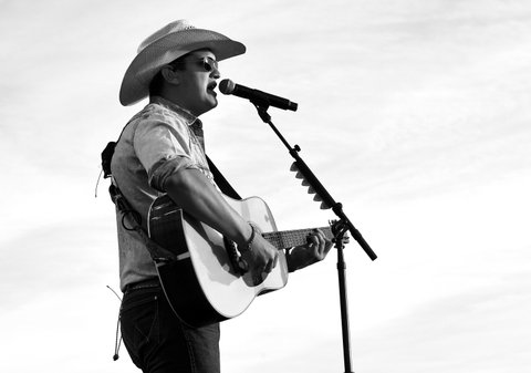 INDIO, CA - APRIL 28:  (EDITORS NOTE: This image has been converted to black and white.)  Musician Jon Pardi performs on the Toyota Mane Stage stage during day 1 of 2017 Stagecoach California's Country Music Festival at the Empire Polo Club on April 28, 2017 in Indio, California.  (Photo by Kevin Winter/Getty Images for Stagecoach)