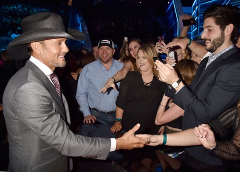 LAS VEGAS, NV - APRIL 02:  Singer Tim McGraw (L) greets fans during the 52nd Academy Of Country Music Awards at T-Mobile Arena on April 2, 2017 in Las Vegas, Nevada.  (Photo by Jeff Kravitz/ACMA2017/FilmMagic for ACM)
