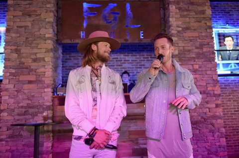 NASHVILLE, TN - JUNE 05:  Musicians Brian Kelley (L) and Tyler Hubbard (R) of Florida Georgia Line give a speech to celebrate their grand opening of FGL House on June 5, 2017 in Nashville, Tennessee.  (Photo by John Shearer/Getty Images for Florida Georgia Line)
