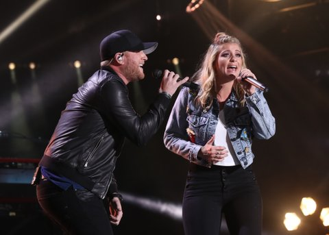 NASHVILLE, TN - JUNE 08:  (EDITORIAL USE ONLY)  Singer-songwriter Cole Swindell and Lauren Alaina perform during day 1 of the 2017 CMA Music Festival on June 8, 2017 in Nashville, Tennessee.  (Photo by Terry Wyatt/WireImage)