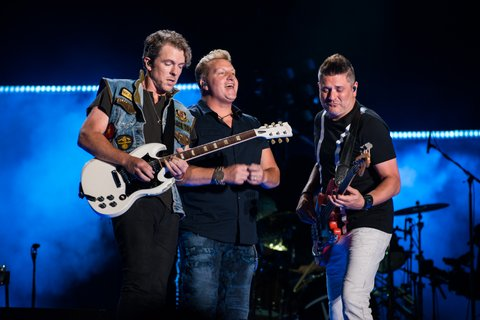 NASHVILLE, TN - JUNE 09: (EDITORIAL USE ONLY) Musicians Joe Don Rooney, Gary LeVox, and Jay DeMarcus of Rascal Flatts perform at Nissan Stadium during day 2 of the 2017 CMA Music Festival on June 8, 2017 in Nashville, Tennessee. (Photo by Richard Gabriel Ford/Getty Images)